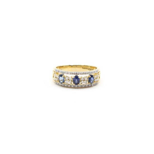 Anillo oro amarillo 18k con zafiro y diamantes